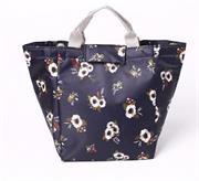 Túi giữ nhiệt hoa cúc nền xanh