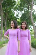 áo dài hai tà màu tím đính cườm