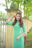 áo dài bốn tà màu xanh ngọc