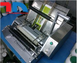 Máy dán nhãn giấy chai tròn bán tự động
